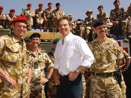 "Tony Blair meets troops in Iraq in ۲۰۰۳. A dossier alleging ""systematic"" war crimes by British forces - sent to Iraq by the former Prime Minister - has been presented to the International Criminal Court (PA)"