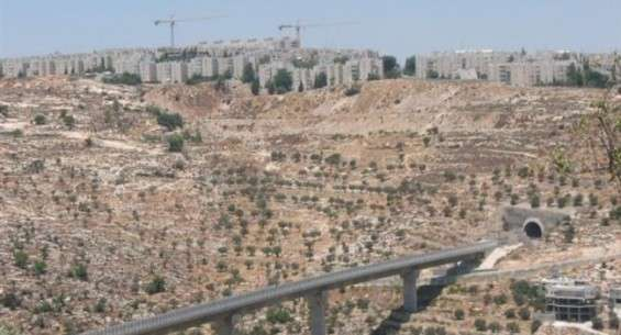 An 'Israeli only' by-pass road that links settlements in the occupied West Bank is shown sitting below an Israeli settlement outside al-Quds (Jerusalem).