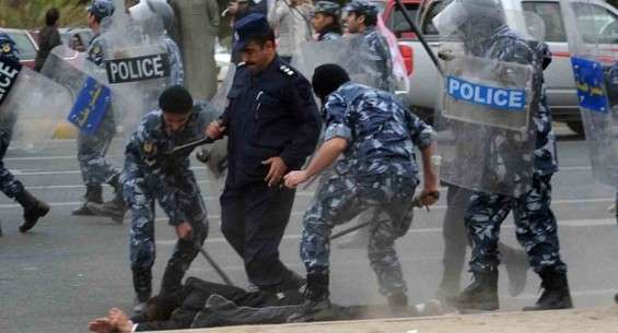 Kuwaiti riot police arrest a stateless Arab man during a demonstration to demand citizenship (AFP)
