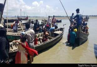 Rohingya people flee from oppression in Myanmar (Photo)